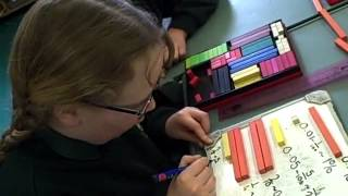 Year 4 and 5 children extending their work with fractions to include decimals and percentages