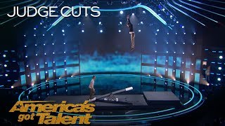 Jules & Jerome: Breathtaking Duo Flips Mid-Air Off Teeterboard - America's Got Talent 2018