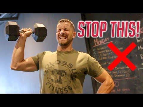Single-Arm Standing Dumbbell Shoulder Press
