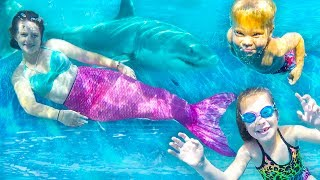 SWIMMING WITH REAL MERMAIDS AND SHARKS IN NEW SWIMMING POOL!
