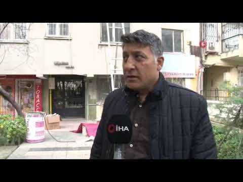 İzmir'de yan yatan bir bina riskli olduğu gerekçesiyle boşaltıldı