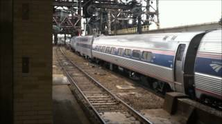 preview picture of video 'ACS-64 #600 plus Other Amtrak at Newark Penn Station 3/14/14'