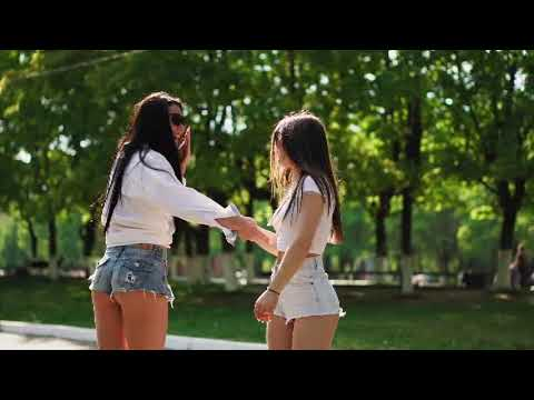 Two hot girls dancing sexy dance in park