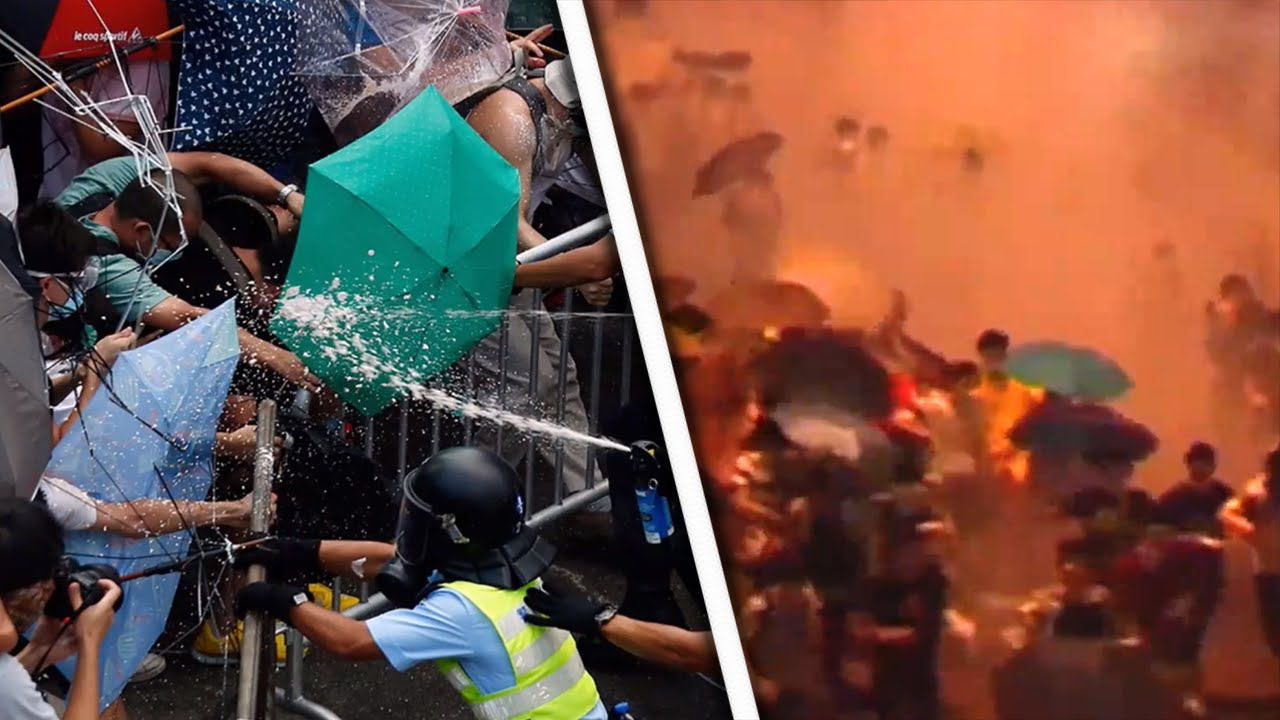 Hong Kong Protesters Fight Police Attacks With Umbrellas thumbnail