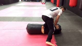 Ground and Pound heavy bag Drill - Free MMA Training Workouts