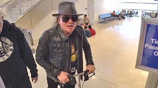 Injured Axl Rose Says He's A 'Big Prince Fan' Jetting Out For AC/DC Tour