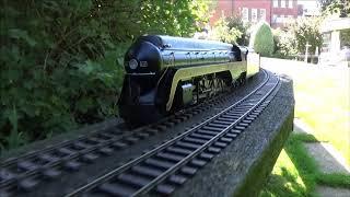 The N & W J class 611 pulling a long train