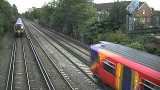 preview picture of video 'Southwest Trains  seen from Dyers Lane footbridge, Barnes (London)'