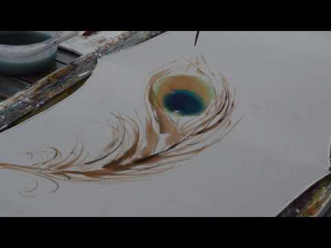 Painting peacock feather on silk scarf