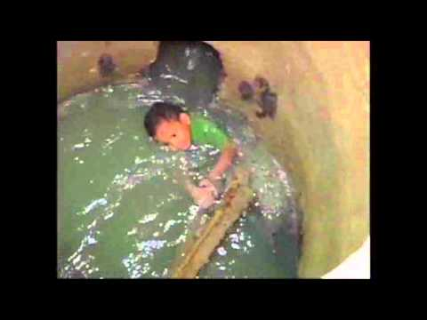 Raw Video: Boy Rescued After Falling Into Sewer