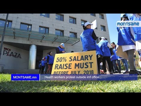 Health workers protest outside IMF office