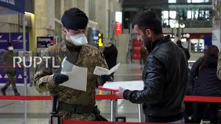 Italy: Police, army enforce lockdown measures at Milan train station