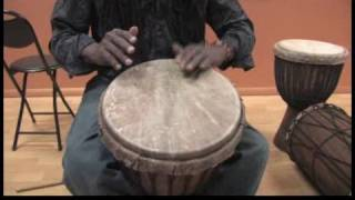 How to Play African Drums : Playing Low African Drums