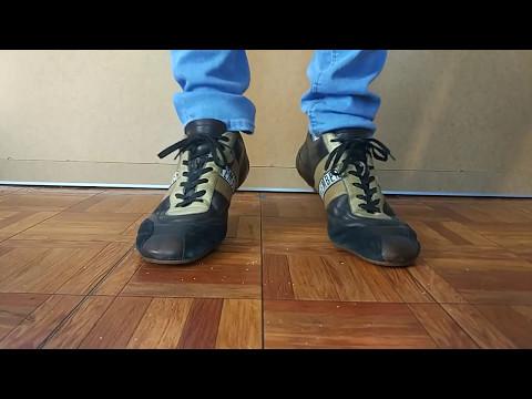 Bikkembergs brown sneakers and blue skinny jeans