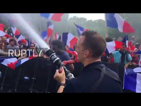 French firefighters HOSE OFF football flames in Paris