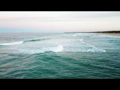 Aerial shots of surf breaking at Kawana