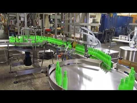 Inline-straightline gravity-pressure liquid filling machine Bottle filler sold by Filling Equipment Co., Inc.