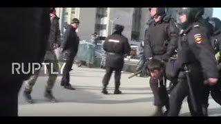 Russia: Clashes and arrests as thousands rally against corruption in Moscow