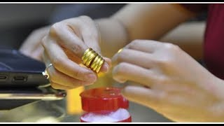 The process of making a 24k gold ring manually