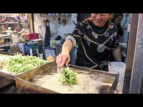 Pancake of Fried Oysters. Strange Chinese Street Food of Hong Kong