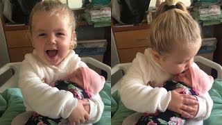 Heartwarming moment 3-year-old girl meets her baby sister for the first time