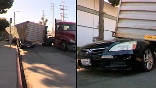 Shipping Container Falls Off Truck and Flattens Car
