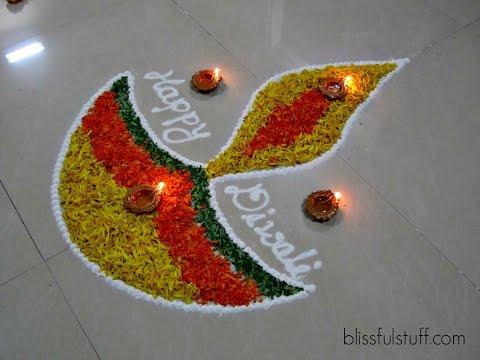 diya rangoli design with marigold flowers by poonam borkar