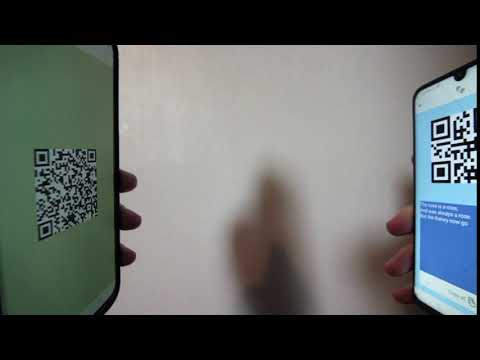 Still from demo video: two phones facing eachother with QR codes showing.