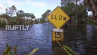 USA:BonitaSpringsresidentswadehomewaist-deepinwaterfollowingIrma