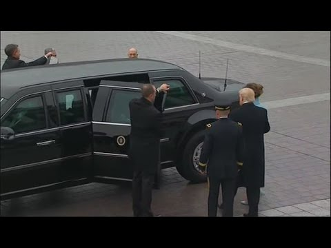 President Trump assists First Lady Melania Trump into limo