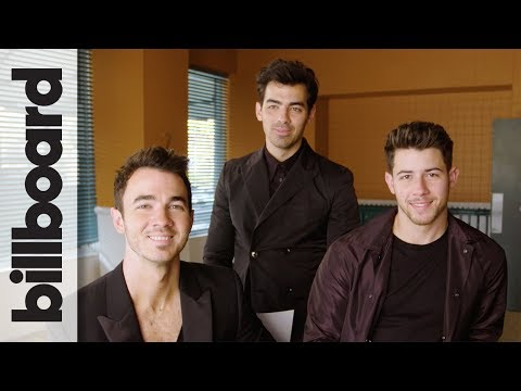 Jonas Brothers Joke About Pranking Each Other & Laugh at Their 2000s Haircuts | Billboard
