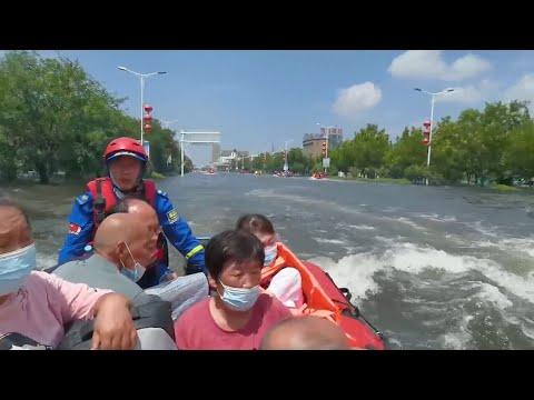 GLOBALink | Heartwarming rescue efforts in rainstorm-battered Henan