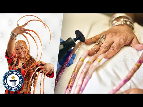 The Longest Fingernails in the World Being Cut