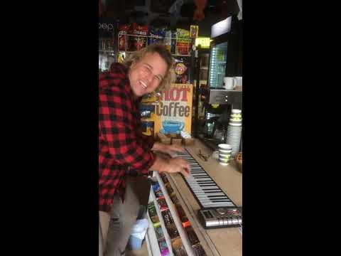 Swiss man rocks on a roll up piano in a small store in CA