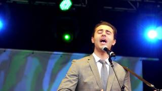 Darius Campbell singing 'Time of Your Life' at Mercedes Benz World.