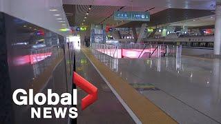 Coronavirus outbreak: Wuhan lockdown leads to empty streets, train stations