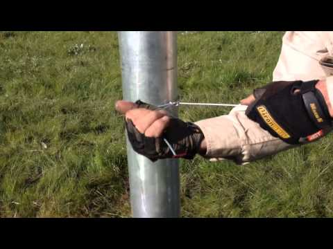 Tying wire to Strainer Post