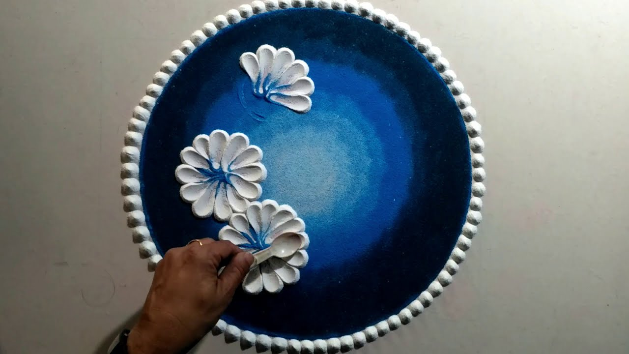 easy rangoli design using spoon by jeet rangoli