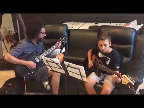 "This is my student Eric and I playing an abridged version of ""Nothing Else Matters"" by Metallica for a school music assignment of his."