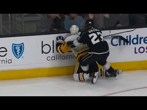 Dustin Brown ejected for boarding on Penguins' Schultz