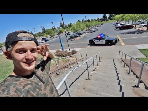 SKATING THE 17 STAIR RAIL (cops called)