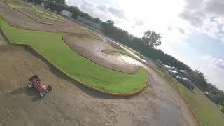 FPV racing drone following Nitro RC car at Nemo Raceway in UK