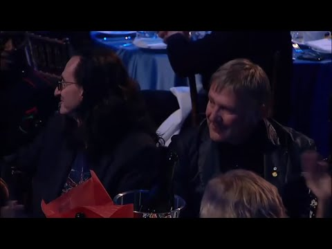 Respect. An audience full of musicians ignores the rest some big name Rock & Roll Hall of Fame inductees and gives Rush a roaring standing ovation.