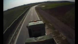 Incredible FPV, RC Plane FPV Flight Chasing Cars Trucks People Under Bridge Low Pass Wind Turbine