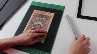 Ed shares how to frame a scroll from the Arcane Scrollworks Collection
