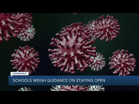 Schools weigh guidance on staying open
