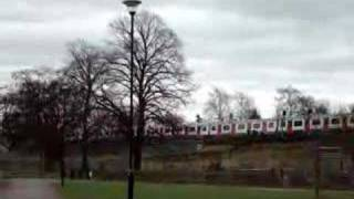 preview picture of video 'District line tube train passing through Acton Green Common'