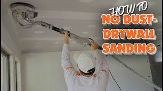 Sanding with an electric drywall vacuum sander