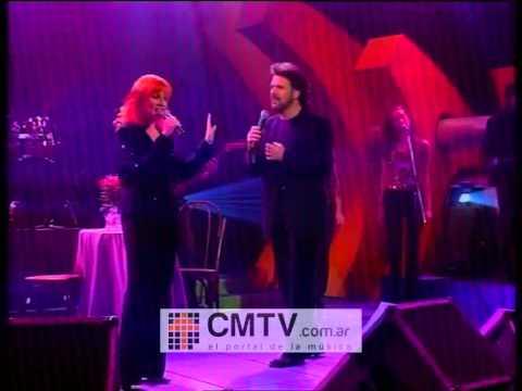 Pimpinela video Olvídame y pega la vuelta - CM Vivo 2001