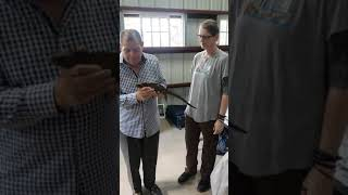 MInister Shaw holding a Jamaican Iguana